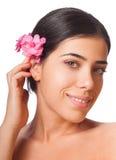 Flicka och blomma royaltyfria bilder