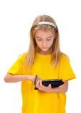 Flicka och e-bok Royaltyfri Fotografi