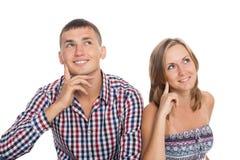 Flicka och grabben som hänsynsfullt ser upp Fotografering för Bildbyråer