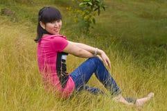 Flicka- och gulingogräs Arkivbilder