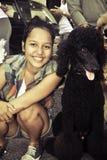 Flicka och hund royaltyfria bilder