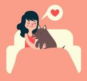 Flicka och hund på soffan Fotografering för Bildbyråer