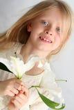Flicka och liljar royaltyfria bilder