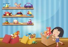 Flicka och många leksaker på hyllor Arkivfoto