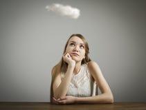 Flicka och moln Arkivfoton