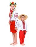 Flicka och pojke i den nationella ukrainska dräkten Arkivbild