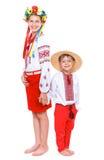 Flicka och pojke i den nationella ukrainska dräkten Royaltyfri Fotografi