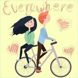 Flicka och pojke på en cykel Arkivfoto