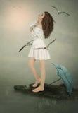Flicka och Seagulls Fotografering för Bildbyråer