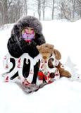 Flicka och snow Arkivbild