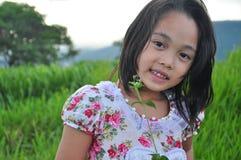 Flicka och solnedgång Royaltyfria Bilder