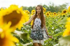 Flicka och solrosor Royaltyfri Bild