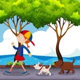 Flicka och två hundkapplöpning som går på gatan stock illustrationer