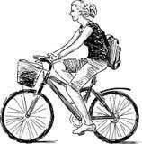 Flicka på cykeln Arkivfoto