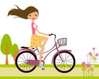 Flicka på cykeln Arkivbilder