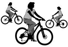 Flicka på cykeln Arkivbild