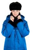 Flicka på det blåa vadderade laget Fotografering för Bildbyråer