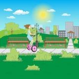 Flicka på en elektrisk sparkcykel i parkera Arkivfoto