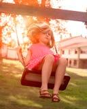 Flicka på en gunga Fotografering för Bildbyråer