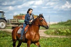 Flicka på en häst Royaltyfria Foton
