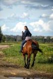Flicka på en häst Royaltyfria Bilder