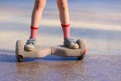 Flicka på en hoverboard Royaltyfria Foton