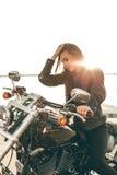 Flicka på en motorcykel Royaltyfri Bild