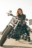 Flicka på en motorcykel Royaltyfria Foton