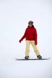 Flicka på en snowboard royaltyfria foton