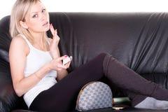 Flicka på en sofa royaltyfria foton