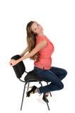 Flicka på en stol Royaltyfria Foton