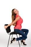 Flicka på en stol Royaltyfria Bilder