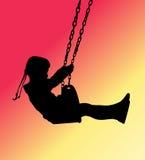 Flicka på en swingsilhouette Royaltyfria Bilder