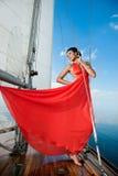 Flicka på en yacht Arkivbilder