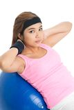 Flicka på gymnastisk boll Royaltyfri Bild