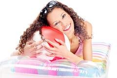 Flicka på luftmadrassen Fotografering för Bildbyråer