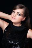 Flicka på mörkerbakgrund Arkivfoto