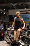 Flicka på motorcykeln Arkivbild