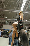Flicka på motorcykeln Arkivfoton