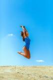 Flicka på sanden Fotografering för Bildbyråer