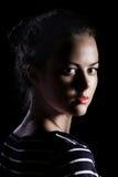 Flicka på svart Royaltyfria Bilder