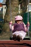 Flicka på swing Arkivbilder
