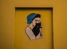 Flicka på väggen Royaltyfri Foto