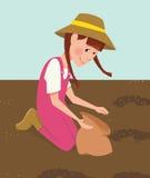 Flicka planterat frö Arkivbild