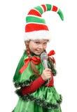 Flicka - Santas älva med en mikrofon Royaltyfri Bild