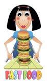 Flicka som äter hamburgaren Arkivfoto