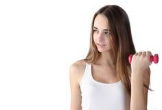 Flicka som övar med hantlar arkivfoton