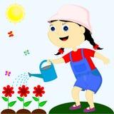 Flicka som bevattnar blommorna Arkivfoton