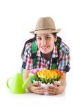 Flicka som bevattnar växter Royaltyfria Foton