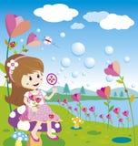 Flicka som blåser bubblor Arkivbild